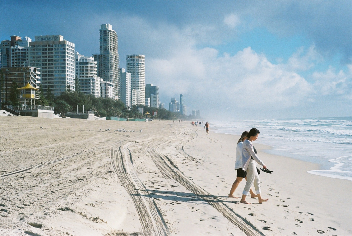 A couple walking at the Gold Coast Beach in Gold Coast, Australia